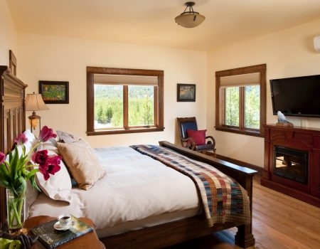 elegant master bedroom with king size bed and luxurious sheets in Ranch House Suite